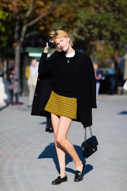 px4owz-l-610x610-skirt-fashion+week+street+style-fashion+week+2016-fashion+week-paris+fashion+week+2016-yellow+skirt-mini+skirt-sweater-black+sweater-coat-black+coat-loafers-black+flats-