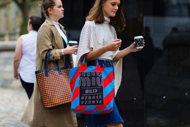 uqjmex-l-610x610-bag-fashion+week+street+style-fashion+week+2016-fashion+week-printed+bag-miu+miu-tote+bag-striped-stripes-asymmetrical-asymmetrical-denim+skirt-skirt--blue+skirt-midi+sk